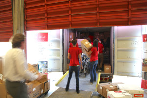 Project CURE Volunteers Loading container for Chemolingot